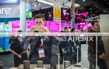 Journalists and visitors check new Sony Xperia devices on the opening day of the World Mobile Congress at the Fira Gran Via Complex on February 22, 2016 in Barcelona, Spain.
