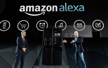 LG Electronics USA Vice President of Marketing David VanderWaal (L) and Amazon Vice President of Alexa,
