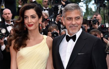 Lawyer Amal Clooney (L) and actor George Clooney