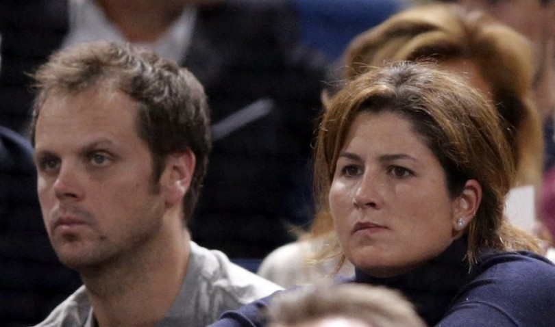 Roger Federer's wife Mirka (R) and his coach Severin Luethi
