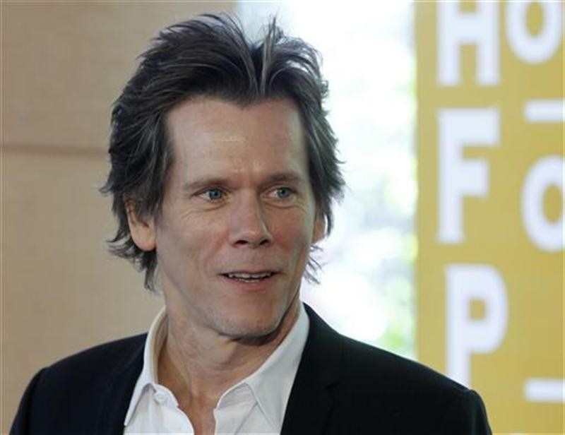 Actor Kevin Bacon arrives for the Hollywood Foreign Press Association Annual Installation Luncheon in Beverly Hills, California August 4, 2011.