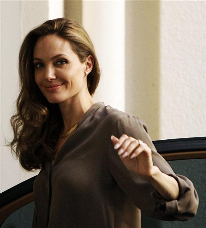U.S. actress Angelina Jolie smiles at fans before the 18th Sarajevo Film Festival July 7, 2012.