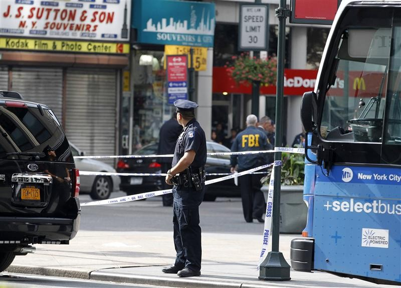 New York City Police and FBI are seen at the scene of a shooting near the Empire State Building in New York, August 24, 2012. Two people were killed and at least eight were wounded in a shooting outsi