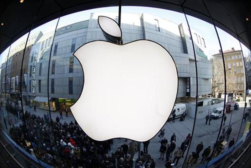 People wait on a street in front of an Apple store as they await sales of the new iPad in the Apple store in Munich March 16, 2012.