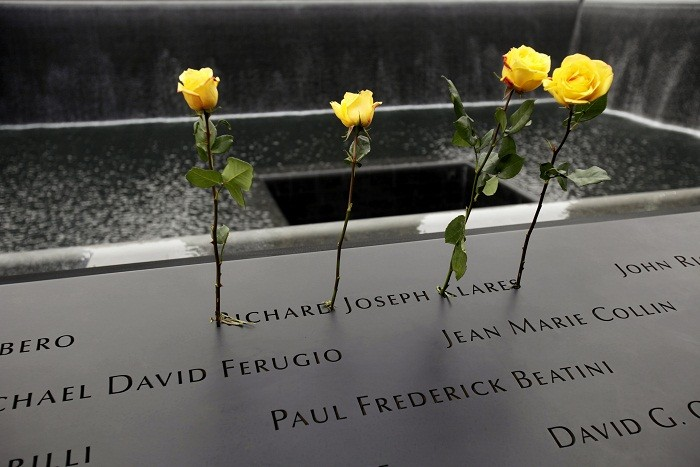 Roses are placed in the name of a person killed on 9/11 at the National September 11 Memorial during tenth anniversary ceremonies at the World Trade Center site in New York, September 11, 2011. The 9/
