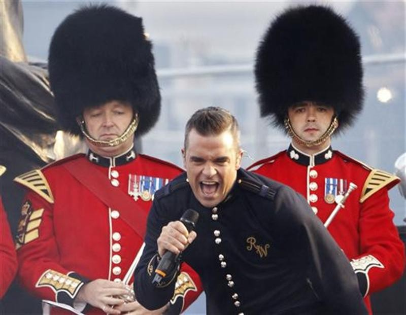 Singer Robbie Williams performs during the Diamond Jubilee concert at Buckingham Palace in London June 4, 2012.
