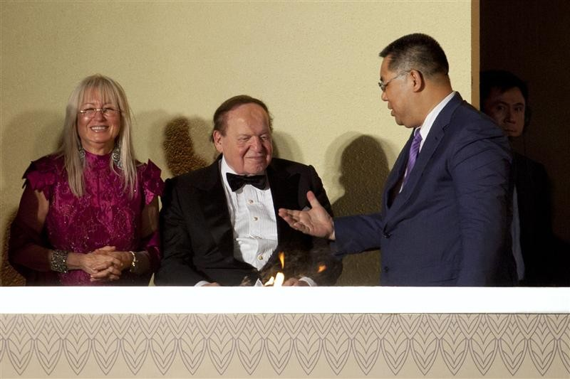 Macau Chief Executive Fernando Chui Sai-On chats with Las Vegas Sands Chairman and CEO Sheldon Adelson