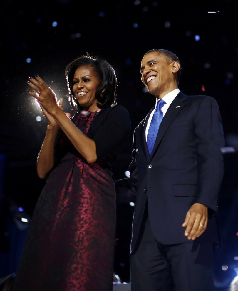 U.S. President Barack Obama and First lady Michelle Obama smile after his re-election victory speech in Chicago November 7, 2012.