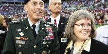 U.S. Central Command chief General David Petraeus and his wife Holly are seen on the field before the Super Bowl XLIII football game between Pittsburgh Steelers and Arizona Cardinals in Tampa, Florida