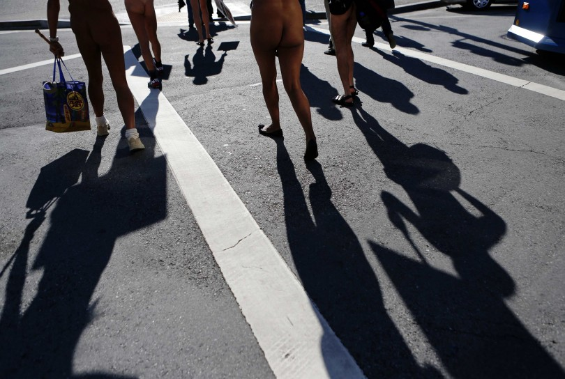 Nudists march to city hall during a rally against banning nudity in parts of the city in San Francisco, California, November 14, 2012. R