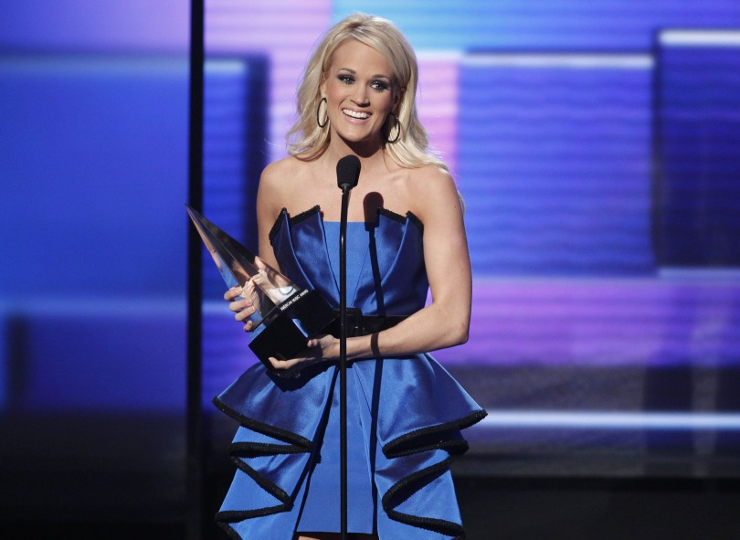 "Carrie Underwood accepts the award for favorite country album for ""Blown Away"" at the 40th American Music Awards in Los Angeles, California, November 18, 2012."