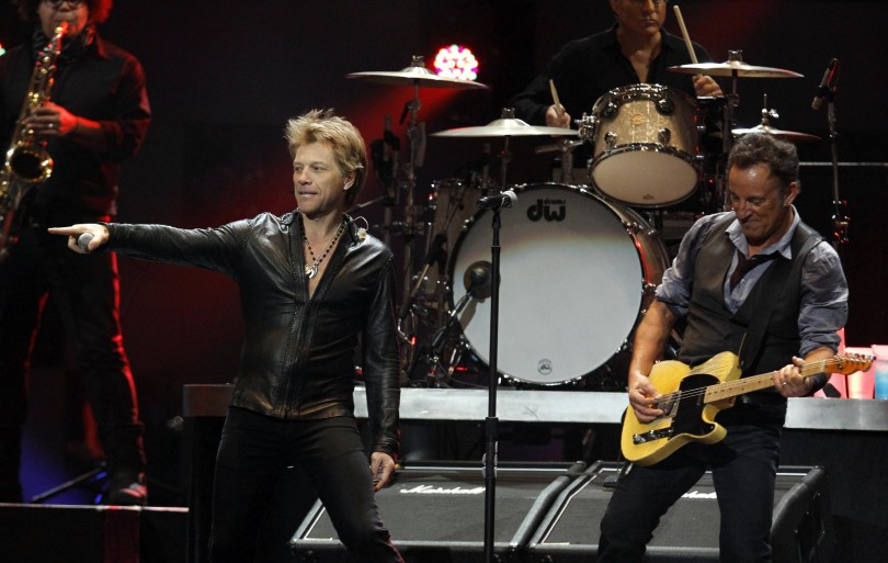 "Jon Bon Jovi joins Bruce Springsteen (R) on stage during the ""12-12-12"" benefit concert for victims of Superstorm Sandy at Madison Square Garden in New York December 12, 2012"