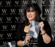 E L James, author of Fifty Shades of Grey, poses for photographers during a book signing in London September 6, 2012.