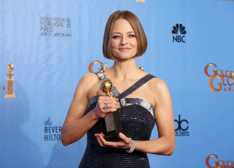 Actress Jodie Foster poses with her Cecil B. DeMille award at the 70th annual Golden Globe Awards in Beverly Hills, California January 13, 2013