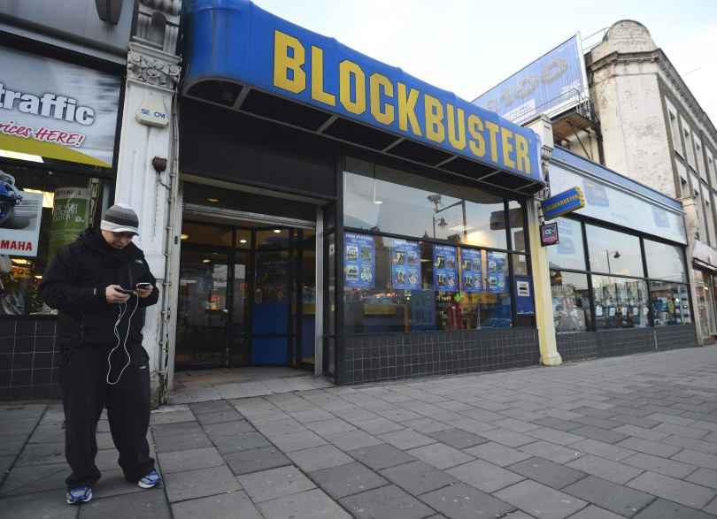 A man stands outside a Blockbuster shop in south London January 16, 2013.