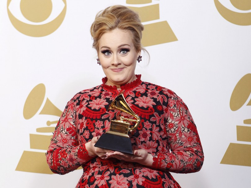 "Adele poses with her Grammy award for Best Pop Solo Performance for her song ""Set Fire To The Rain [Live]"" backstage at the 55th annual Grammy Awards in Los Angeles, California February 10, 2013."